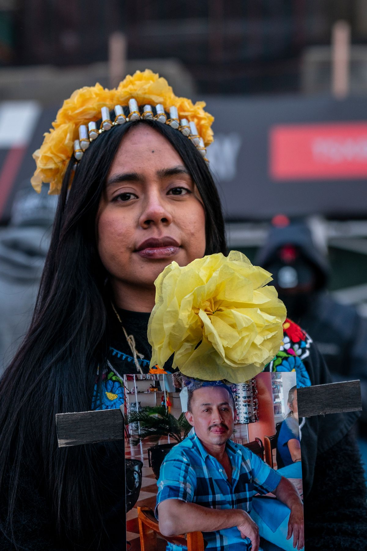 Yessenia Benítez took part in the Mexicanos Unidos march to honor her uncle who was killed from gun violence, Oct. 31, 2020.