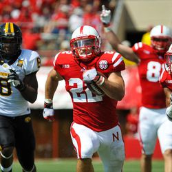 Nebraska's Rex Burkhead (22) gets past Southern Mississippi's Jamie Collins (8) for a 57-yard touchdown run in the first quarter of an NCAA college football game, Saturday, Sept 1, 2012, in Lincoln, Neb.