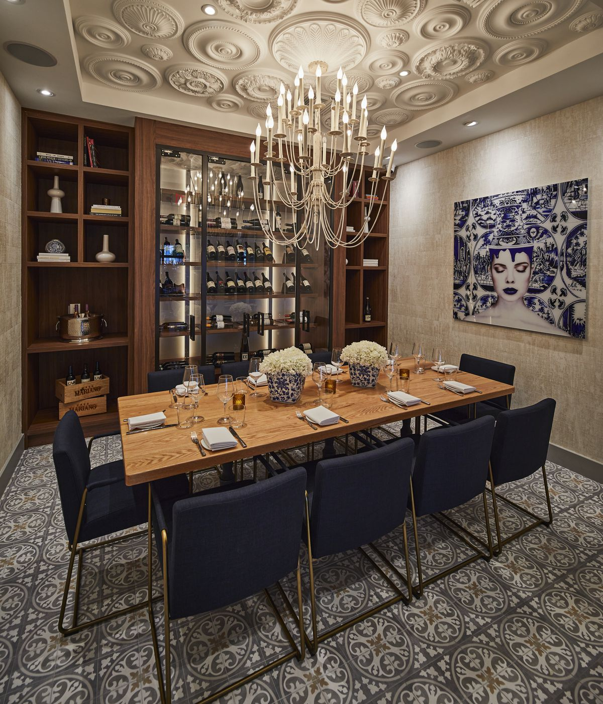 dining room with blue seats, brown table, large chandelier