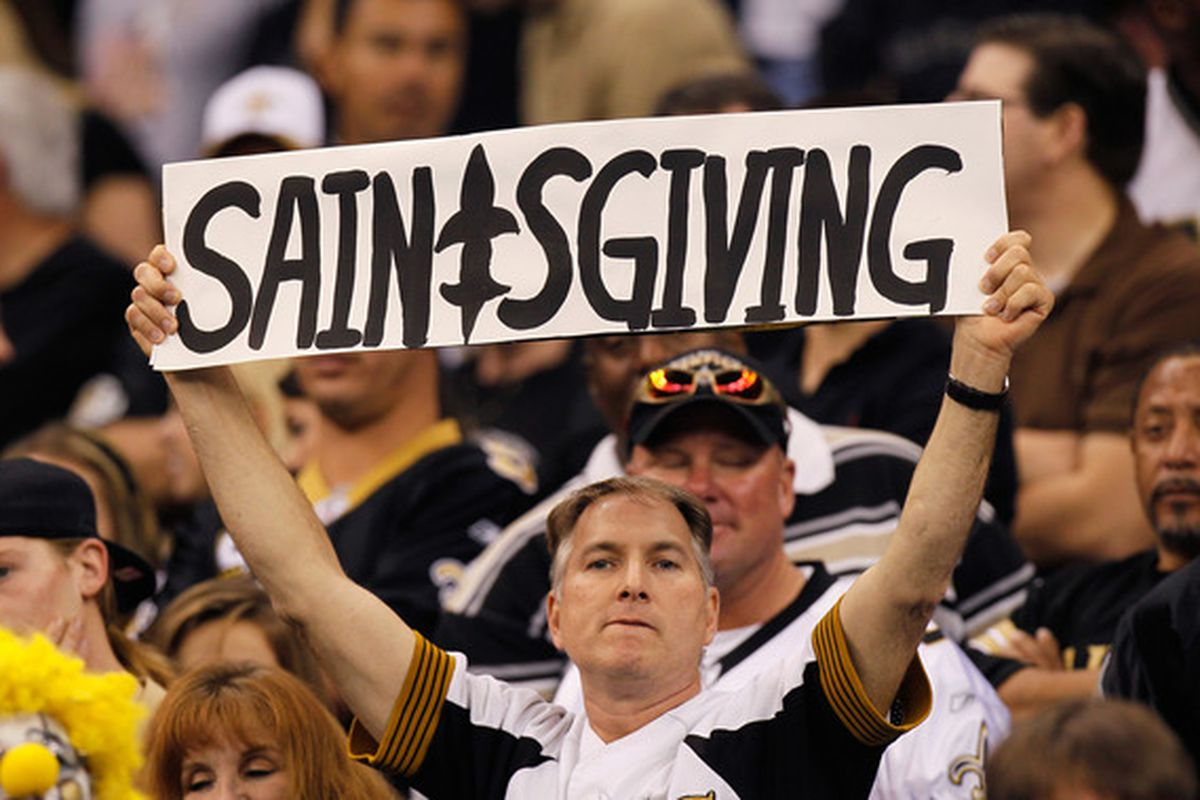 """NEW ORLEANS - NOVEMBER 21:  A fan of the New Orleans Saints holds up a sign for """"Saintsgiving"""" during the sign against the Seattle Seahawks at Louisiana Superdome on November 21 2010 in New Orleans Louisiana.  (Photo by Kevin C. Cox/Getty Images)"""