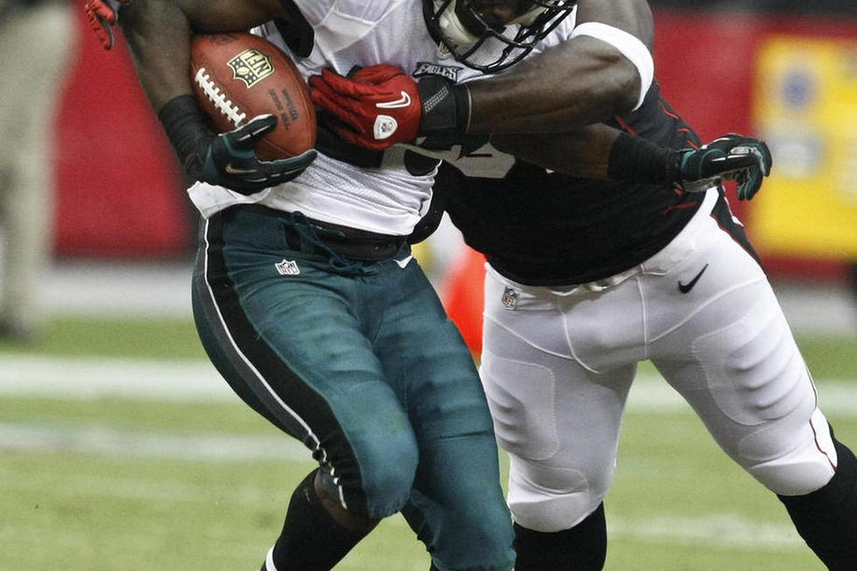 Arizona Cardinals' Vonnie Holliday, right, tackles Philadelphia Eagles' LeSean McCoy (25) during the second half of an NFL football game on Sunday, Sept. 23, 2012, in Glendale, Ariz.