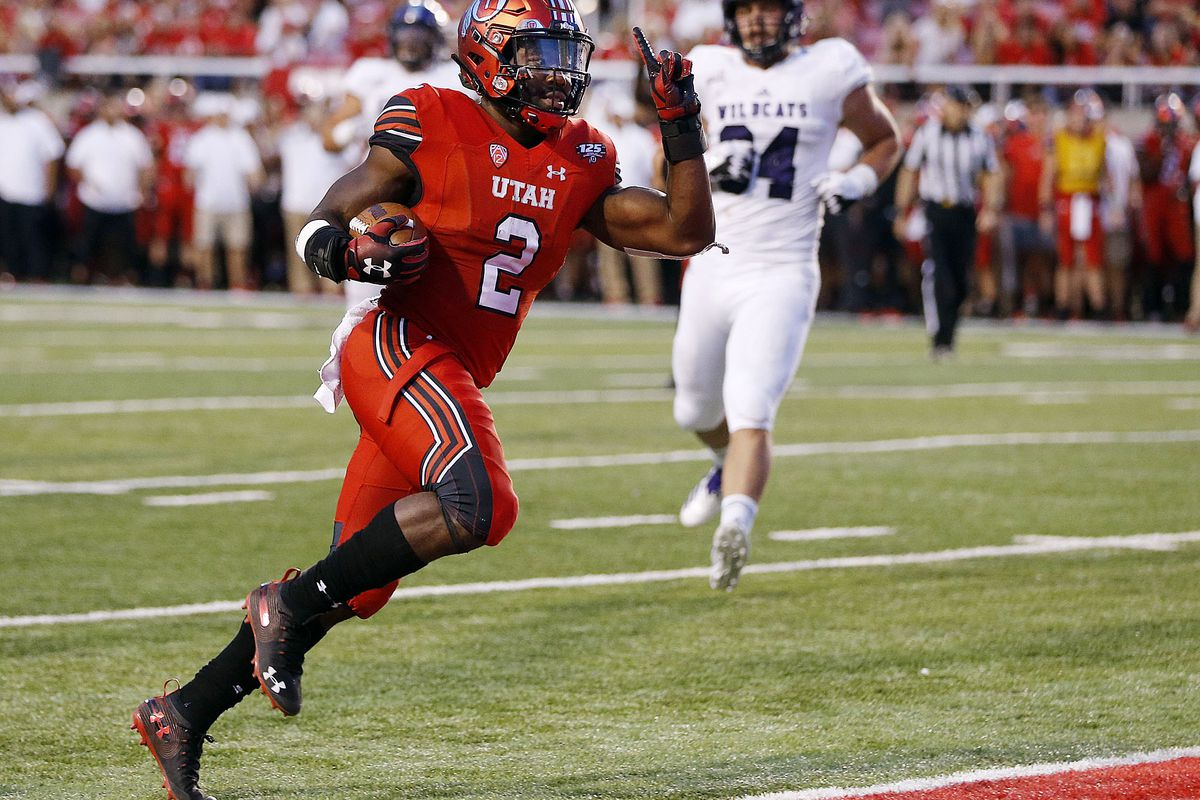Utah Utes running back Zack Moss breaks free for a touchdown against the Weber State Wildcats during NCAA football in Salt Lake City on Thursday, Aug. 30, 2018.