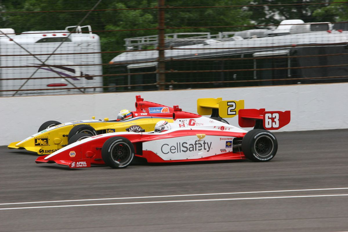 O2 Racing Technology's Mikael Grenier (63) battles Gustavo Yacaman during the Firestone Indy Lights Series Freedom 100 at Indianapolis Motor Speedway in May 2011. (Photo: IndyCar.com)