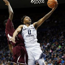 Brigham Young Cougars guard Jahshire Hardnett (0) puts in a layup with Texas Southern Tigers forward Lamont Walker (14) defending as BYU and Texas Southern play an NCAA basketball game in Provo at the Marriott Center on Saturday, Dec. 23, 2017.