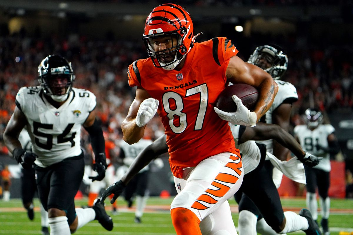 Cincinnati Bengals tight end C.J. Uzomah (87) catches a pass on a touchdown in the fourth quarter during a Week 4 NFL football game against the Jacksonville Jaguars, Thursday, Sept. 30, 2021, at Paul Brown Stadium in Cincinnati.