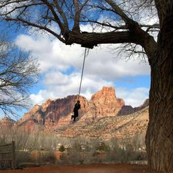 A young boy on a swing in Colorado City, Arizona on the Utah border next to the twin city of Hildale, Utah Thursday, Feb. 19, 2004.