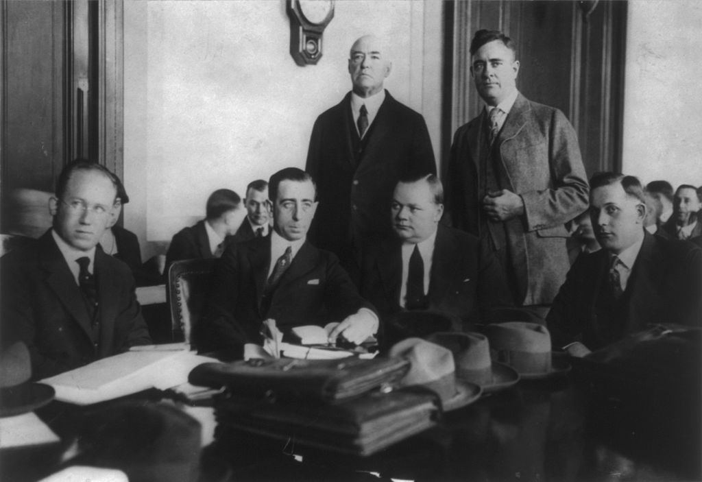 "Roscoe ""Fatty"" Arbuckle and his defense lawyers at his first trial in November 1921."