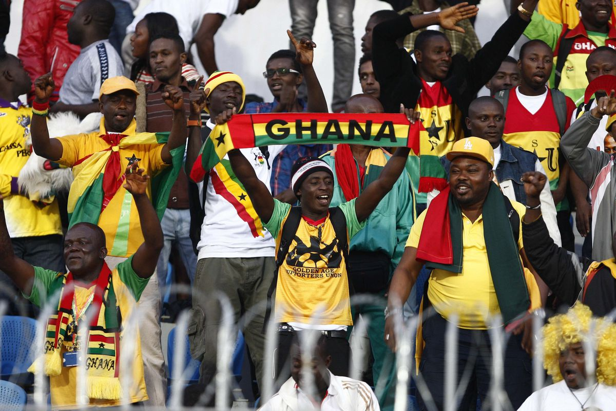 Ghanaian football fans cheer during the FIFA World Cup 2014 African zone football qualifier second leg play-off on November 19, 2013 in Cairo, Egypt.