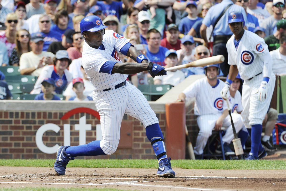 Alfonso Soriano of the Chicago Cubs hits an RBI single against the Pittsburgh Pirates, giving him 100 RBI's for the season on September 16,  2012 at Wrigley Field in Chicago, Illinois.   (Photo by David Banks/Getty Images)