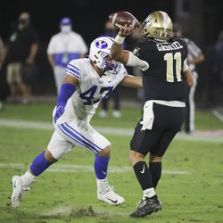 Brigham Young Cougars linebaker Pepe Tanuvasa hurries UCF Knights quarterback Dillon Gabriel (11) during the Boca Raton Bowl in Boca Raton, Fla., on Tuesday, Dec. 22, 2020.