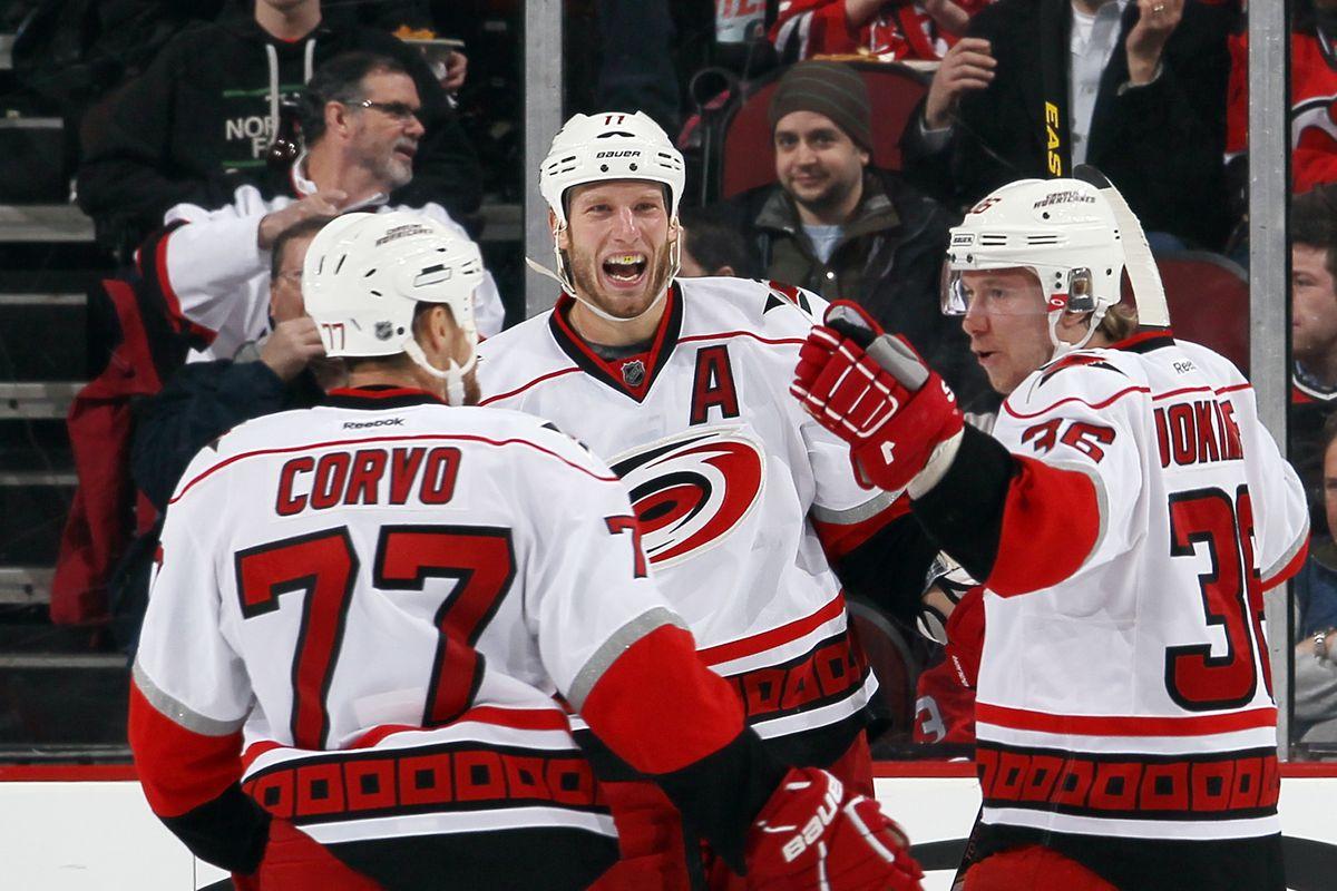 Jussi Jokinen celebrates his goal with teammates Joe Corvo and Jordan Staal