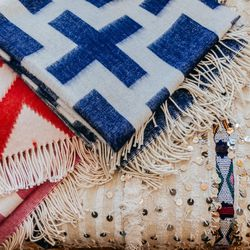 Baby alpaca throws ($295/each) and Moroccan wedding blankets ($450-$895)