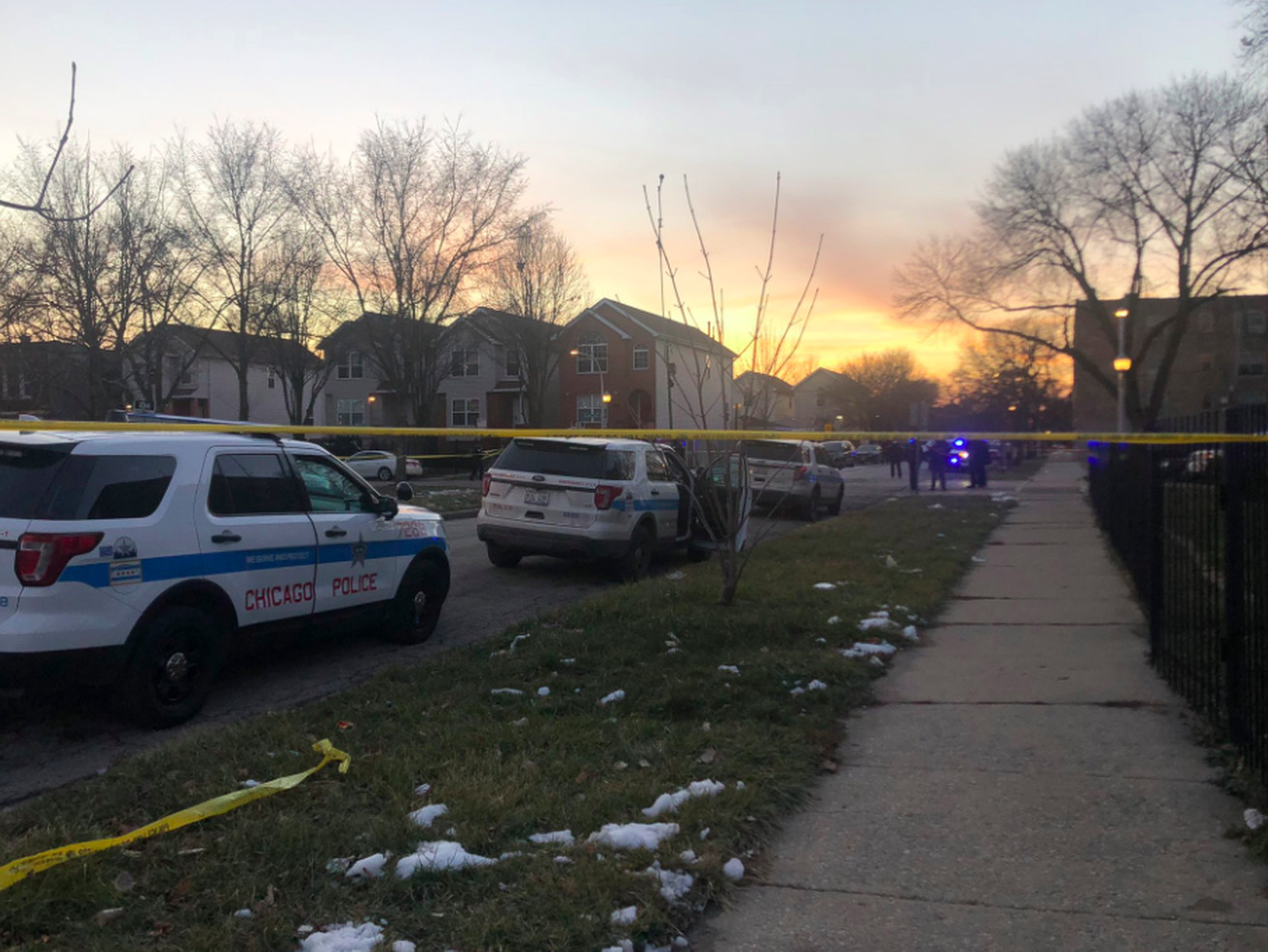Authorities investigate after a person was shot by police Saturday in the 1500 block of South Karlov.