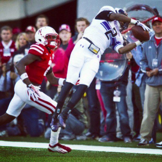 Dwight White II picks off a pass in 2013 while a Northwestern University cornerback. The next year an injury led him to leave the squad.