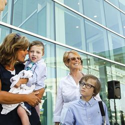 Dash Johnson, 4, middle, a patient at Primary Children's Hospital, arrives for the reopening of the Angel Garden at the hospital in Salt Lake City on Monday, Aug. 1, 2016. The redesigned garden includes more than 1,000 new plants and trees, as well as legacy monuments, including the Butterfly Angel statue, a commissioned 5-foot bronze. Dash's family spearheaded renewal project.