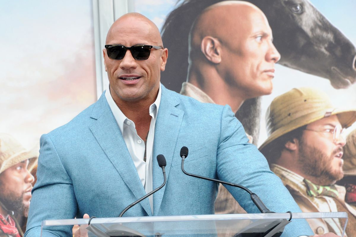 Dwayne Johnson speaks at Kevin Hart's Hand And Footprint Ceremony At the TCL Chinese Theatre IMAX held at TCL Chinese Theatre on December 10, 2019 in Hollywood, California.
