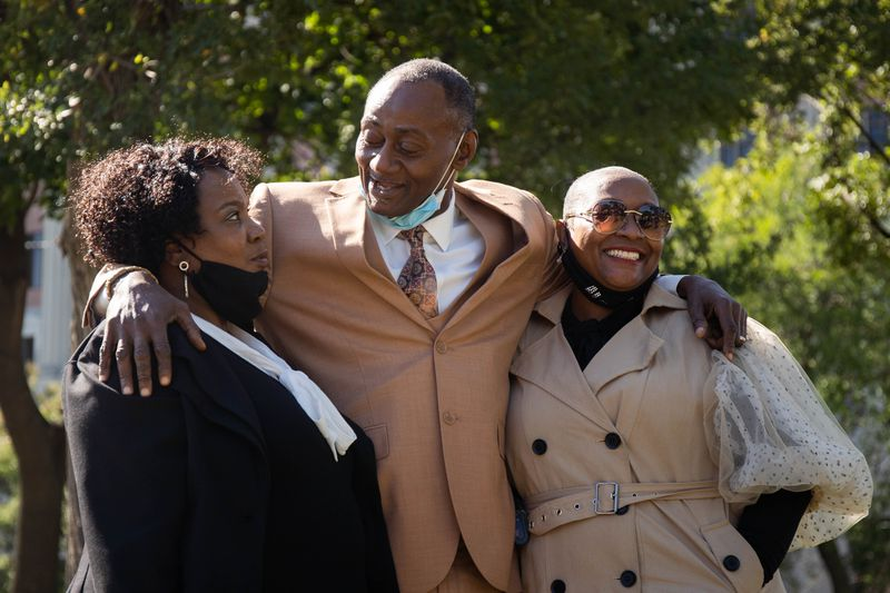 Jackie Wilson, with his wife Sandra and niece Candace, laugh outside the Cook County Criminal Court on Oct. 2, 2020.