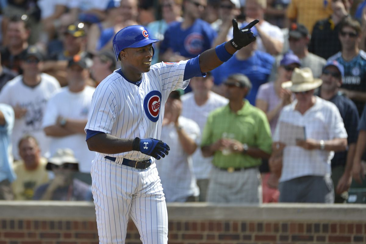 Alfonso Soriano of the Chicago Cubs points to the crowd after hitting a two-run home run scoring teammate Anthony Rizzo against the San Francisco Giants at Wrigley Field in Chicago, Illinois.  (Photo by Brian Kersey/Getty Images)