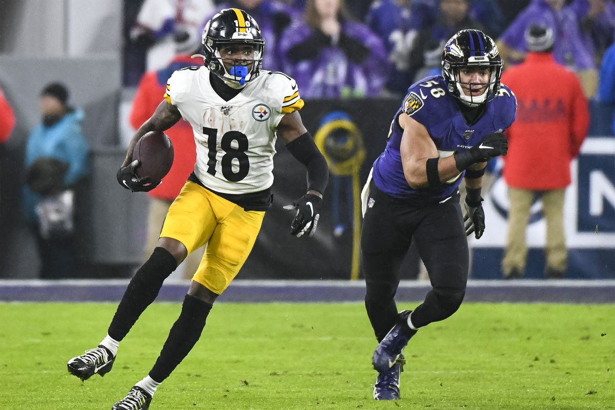 Pittsburgh Steelers wide receiver Diontae Johnson makes a reception against Baltimore Ravens linebacker L.J. Fort on December 29, 2019, at M&T Bank Stadium in Baltimore, MD.