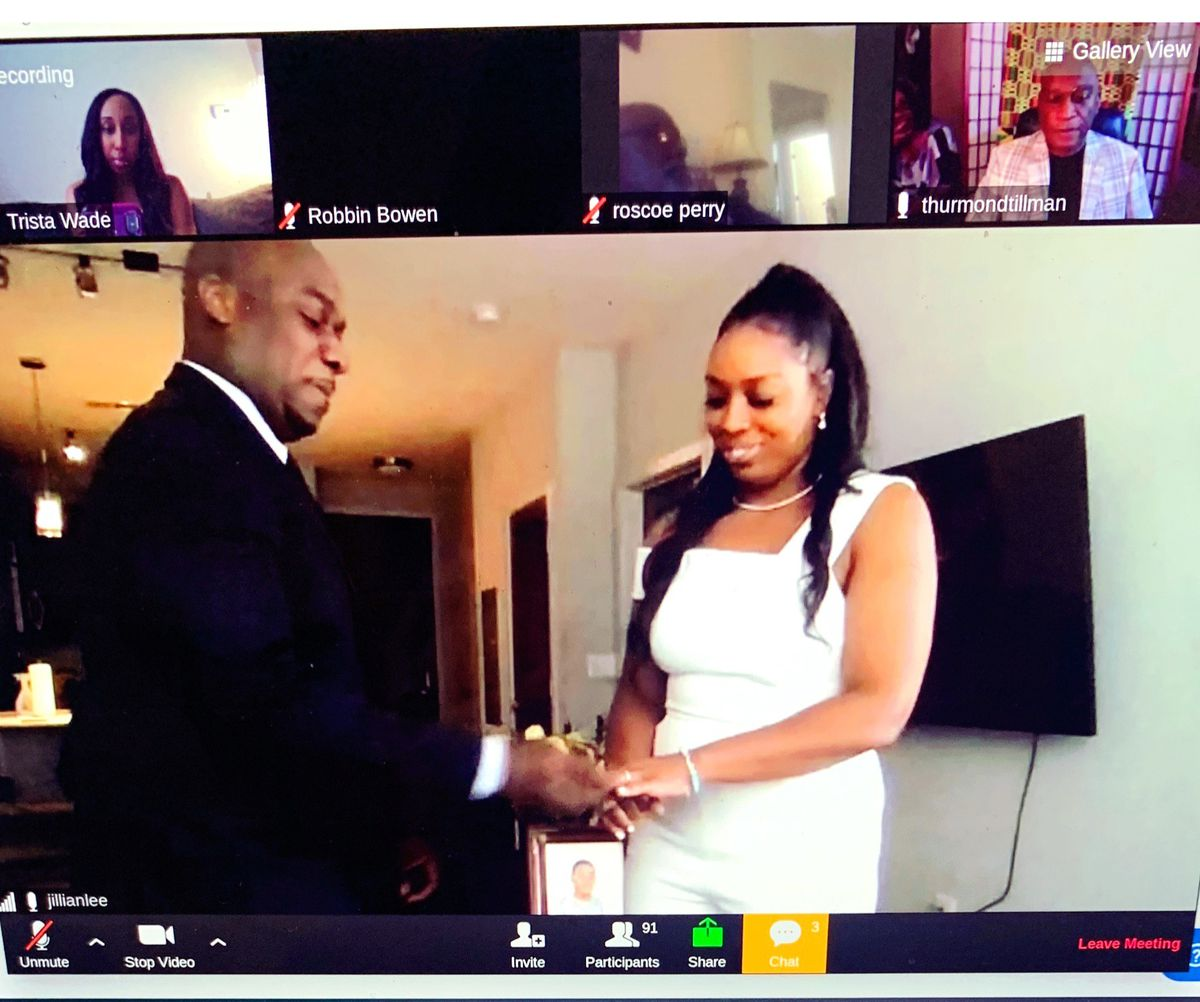 A computer screenshot of the couple marrying as friends and family watched on Zoom.