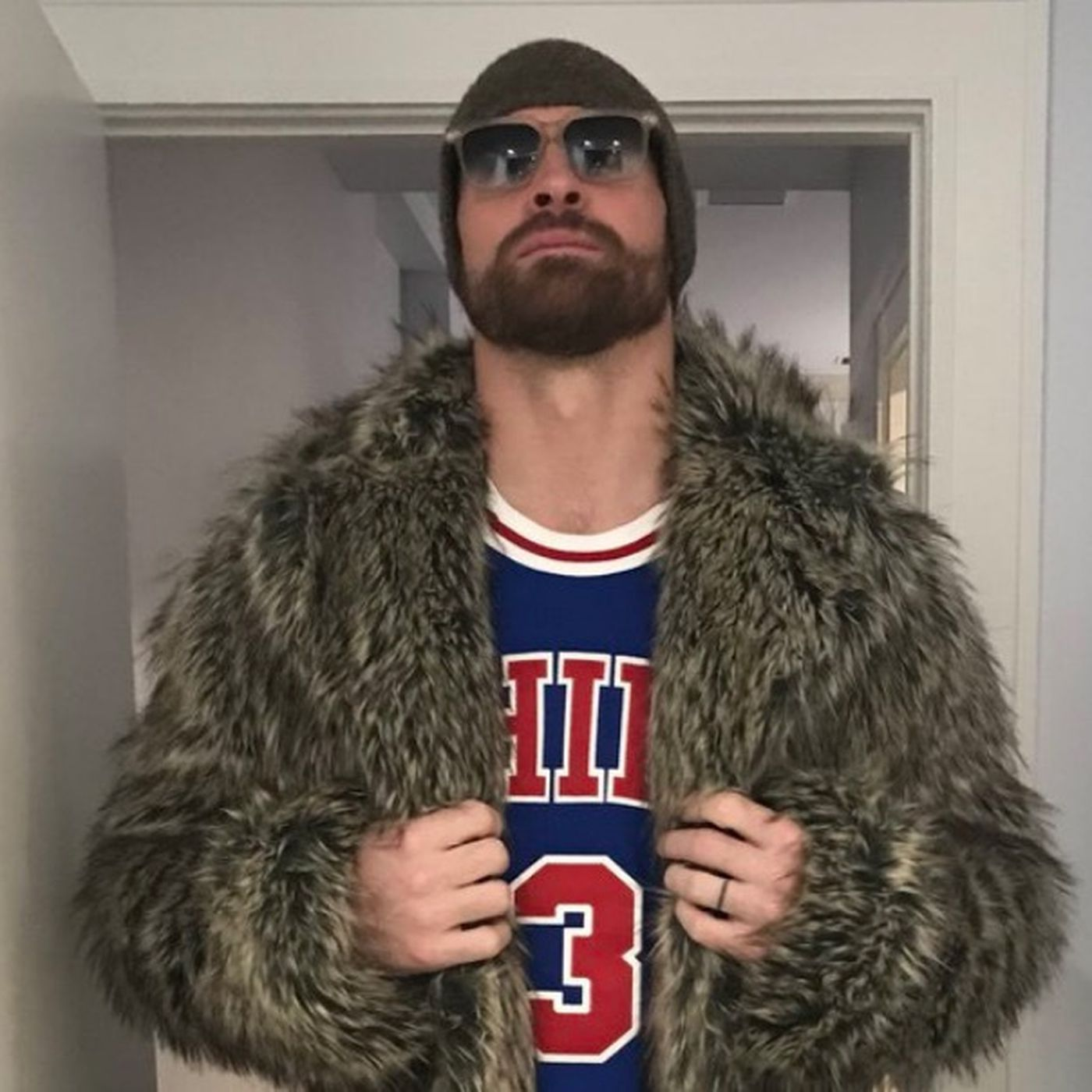 cheap for discount e92c1 65843 Chris Long is wearing an Allen Iverson jersey and 'fur' coat ...