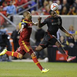 Toronto FC defender Doneil Henry (15) heads the ball in front of Real Salt Lake forward Alvaro Saborio (15) during a game at Rio Tinto Stadium in Sandy on Saturday, March 29, 2014.