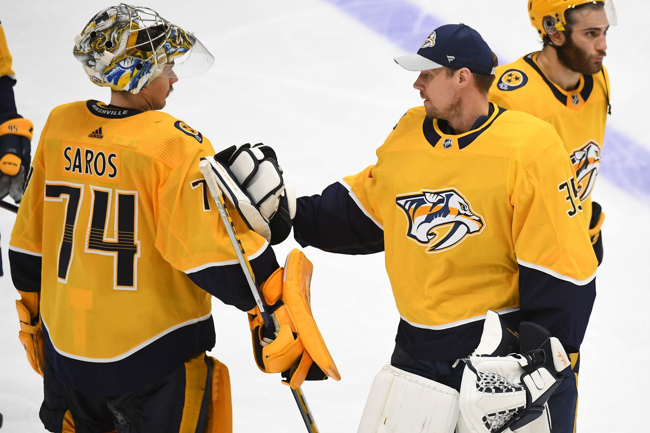 Nashville Predators goaltender Juuse Saros (74) meets with goaltender Pekka Rinne (35) after an overtime loss against the Carolina Hurricanes in game six of the first round of the 2021 Stanley Cup Playoffs at Bridgestone Arena.