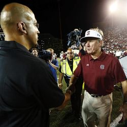 South Carolina head coach Steve Spurrier, right, shakes hands with Vanderbilt head coach James Franklin following their NCAA college football game, Thursday, Aug. 30, 2012, in Nashville, Tenn. South Carolina won 17-13.
