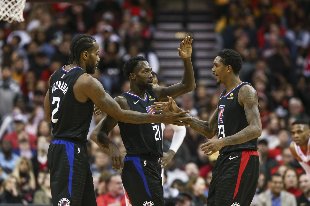 Los Angeles Clippers forward Kawhi Leonard and guard Patrick Beverley and guard Lou Williams celebrate after a play during the fourth quarter against the Houston Rockets at Toyota Center.