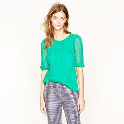 "<a href= ""http://www.jcrew.com/womens_feature/catalogjcrewcomexclusives/onlineshops/shirts/PRDOVR~59142/99102819484/ENE~1+2+3+22+4294967294+20~450~~20+17~90~~~~~~~/59142.jsp"">Silk pintuck blouse in emerald</a>, $65.99"