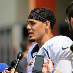 Broncos S Justin Simmons talks with the media after practice.
