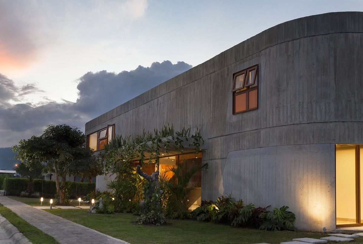 Facade of concrete house with curved sides