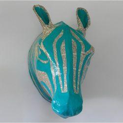 "<a href=""http://www.dwellstudio.com/home-decor-accents/wall-decor/zebra-sky-papier-mache-head.html""> Dwell Studio Zebra Skye papier mache zebra head</a>, $76 dwellstudio.com"