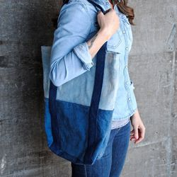 """Natural indigo tote with vintage brass detailing, $115 from <a href=""""http://www.etsy.com/shop/squidwhaledesigns"""">SquidWhale Design</a>"""