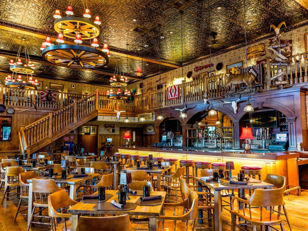 Dimly-lit western saloon interior