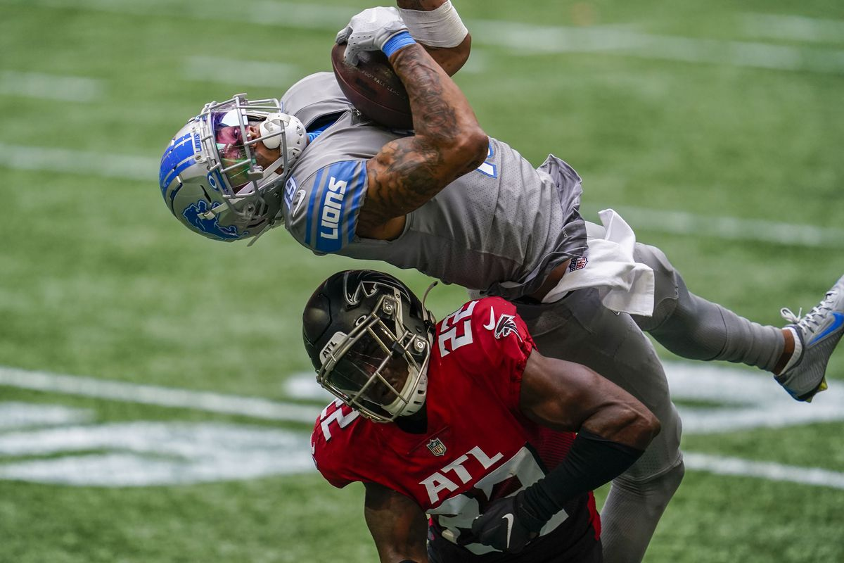 Lions wide receiver Kenny Golladay (19) makes a catch over Atlanta Falcons safety Keanu Neal (22) during the second half at Mercedes-Benz Stadium.