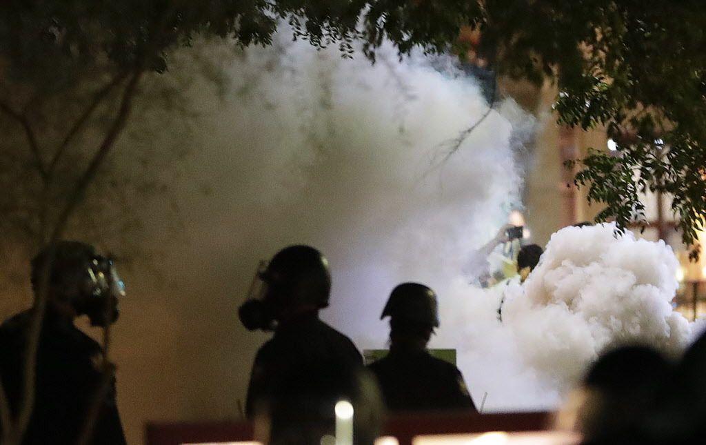 Smoke billows after Phoenix police used tear gas outside the Phoenix Convention Center.   Matt York/AP