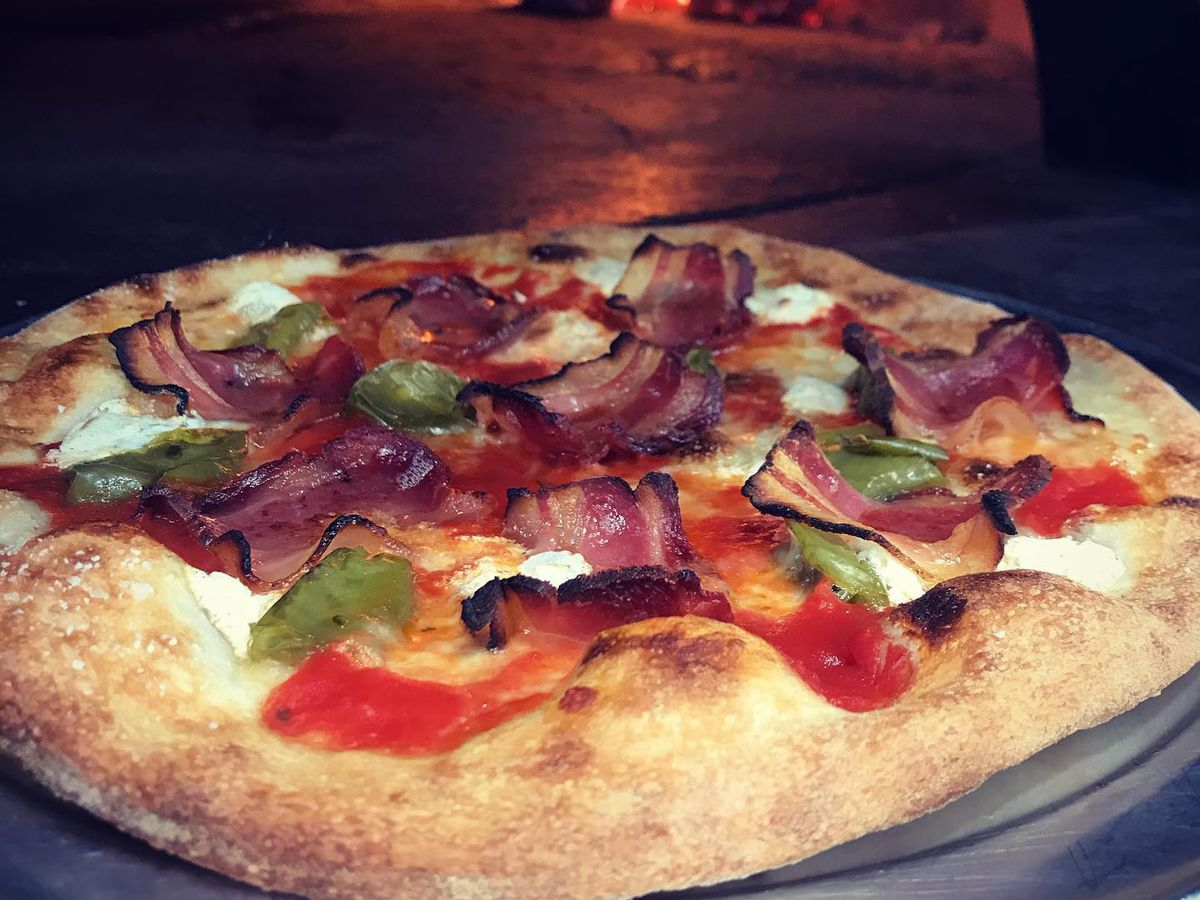 pizza in front of wood-burning pizza oven from Firewall Food Stop in Westview Atlanta