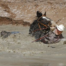 Former Utah Jazz center Mark Eaton and Big Tim, Eaton's Clydesdale/thoroughbred horse, are swept away after hitting a deep hole while crossing the San Rafael River.