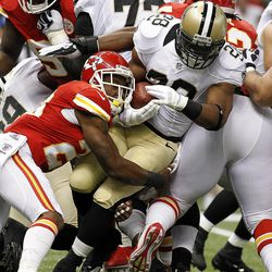 New Orleans Saints running back Pierre Thomas (23) carries as Kansas City Chiefs strong safety Eric Berry (29) tackles in the first half of an NFL football game at the Mercedes-Benz  Superdome in New Orleans, Sunday, Sept. 23, 2012.