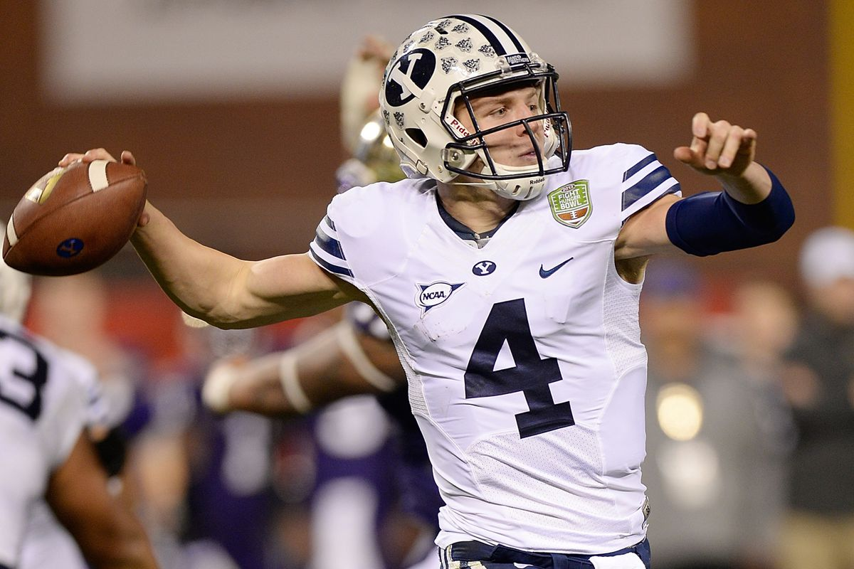 SAN FRANCISCO, CA - DECEMBER 27: Taysom Hill #4 of the BYU Cougars rolls out to pass against the Washington Huskies during the second quarter in the Fight Hunger Bowl at AT&T Park on December 27, 2013 in San Francisco, California.