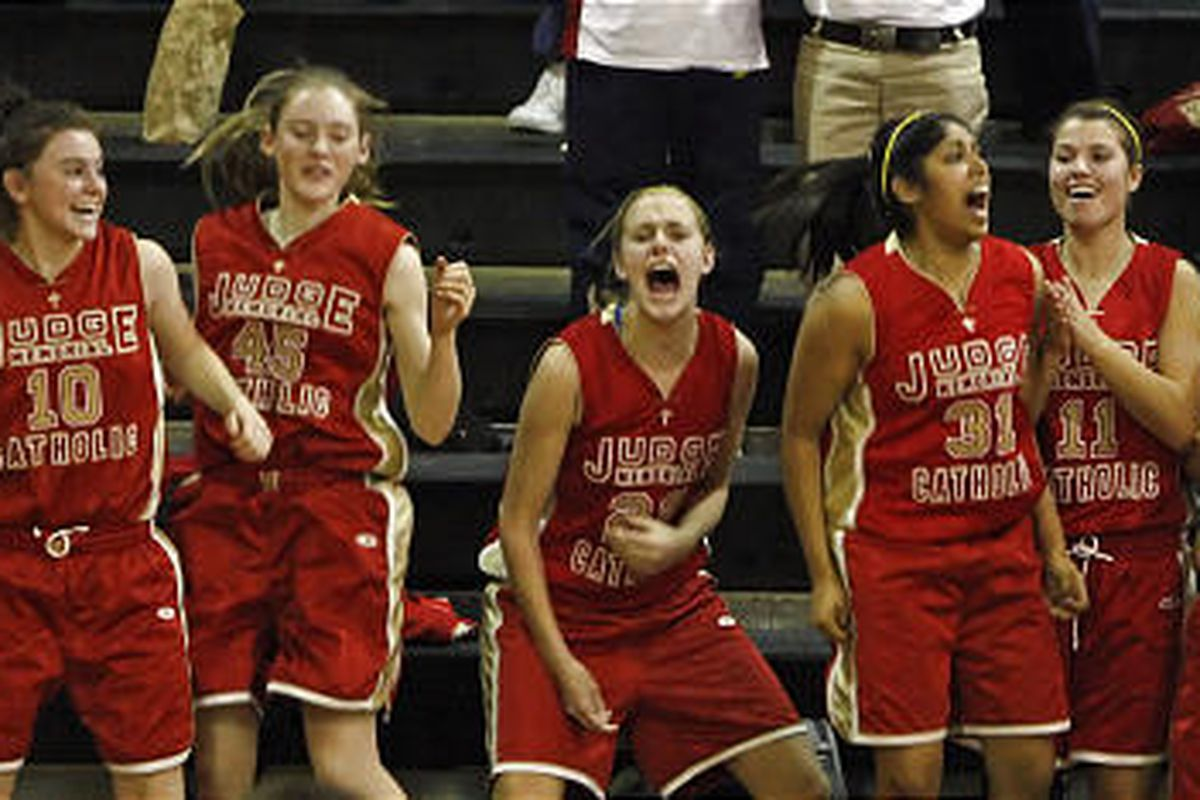 Judge coach Jeremy Chatterton, far right, and bench react as the Lady Bulldogs hit a buzzer-beater.