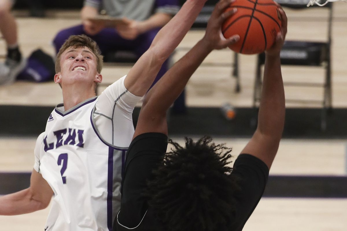 Lehi's Tyson Hawkins, right, blocks the shot of Bountiful's Rob Whaley during a game at Lehi High School on Friday, Dec. 11, 2020.