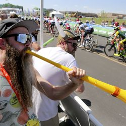 Justin Time and Andrew Messner cheer on cyclists during Stage 1 of the Tour of Utah in North Logan on Tuesday, Aug. 13, 2019.