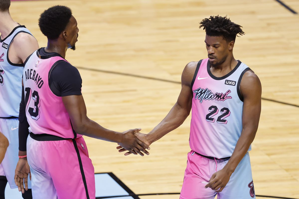 Bam Adebayo and Jimmy Butler of the Miami Heat celebrate against the Oklahoma City Thunder during the third quarter at American Airlines Arena on January 04, 2021 in Miami, Florida.