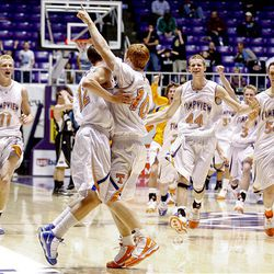 Timpview's Christian Covey, center, leaps into the arms of Ryan Sagers to celebrate.