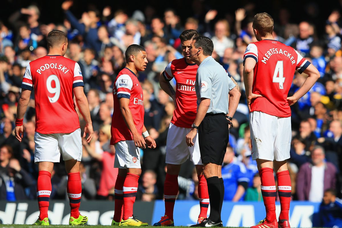 A rare photo of a player actually arguing to get a red card