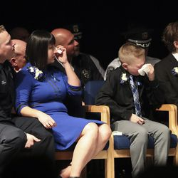 Herriman Police Sgt. Ben Ricks and his family mourn during memorial services for K-9 Hondo at Herriman High School in Herriman on Saturday, Feb. 29, 2020. The 7-year-old Belgian Malinois was shot and killed in the line of duty on Feb. 13 while trying to apprehend a wanted violent fugitive who was also shot and killed after officers say he displayed a gun. Ricks was Hondo's handler.
