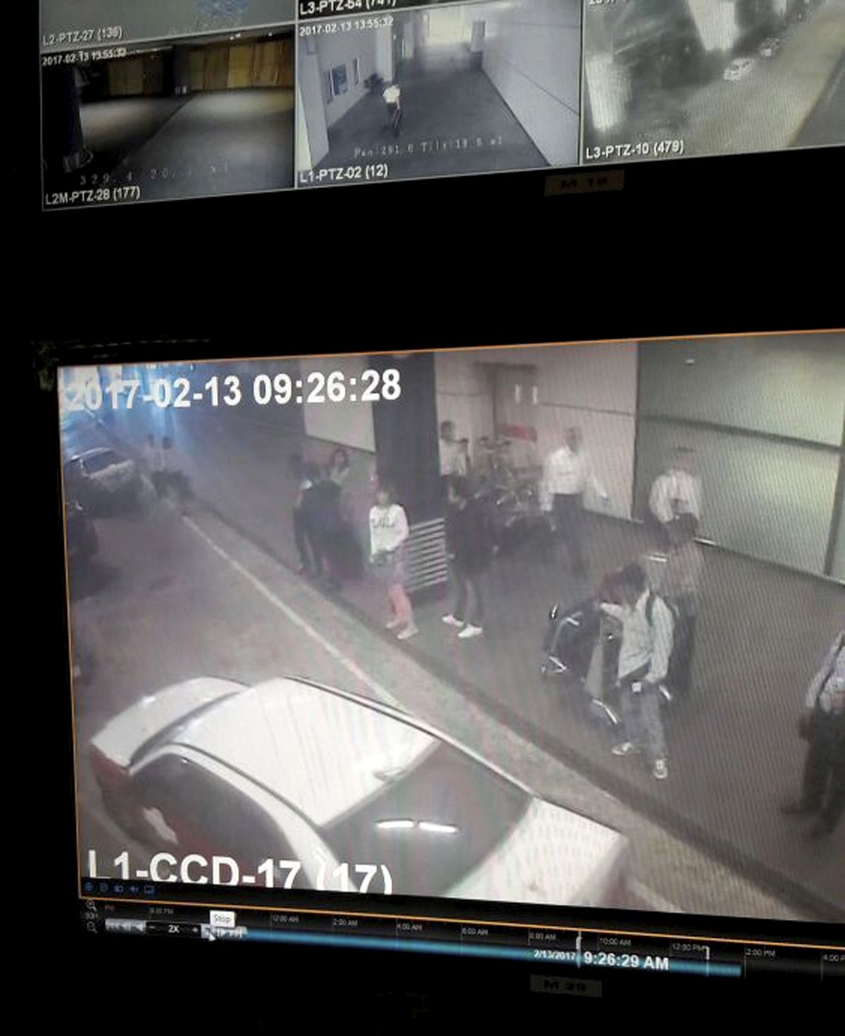 This image provided by Star TV is from  closed circuit television footage. It shows a woman, (center in white) at Kuala Lumpur International Airport in Malaysia. Police say she was arrested Wednesday in connection with the death of Kim Jong Nam, the half