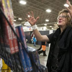 Deak Santy reacts to finding some rare Japanese DVDs during Salt Lake Comic Con at the Salt Palace Convention Center in Salt Lake City, Thursday, Sept. 4, 2014.